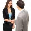 Businesswoman and businessman shaking hands — Stock Photo #5030329