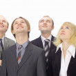 Closeup portrait of many men and women smiling and looking upwards — Stock Photo #5045742