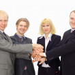 Top view of happy business colleagues with their hands together gesturing u — Stock Photo