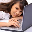 Attractive woman with laptop in hands smiling — Stock Photo