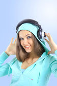 The beautiful young woman with headphones — Стоковое фото