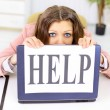 The beautiful business woman at office asks of the help — Stock Photo