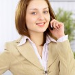 The beautiful business woman at office — Stock Photo #5334860