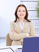 The beautiful business woman at modern office — Stock fotografie