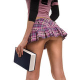 Short skirt and book — Stock Photo