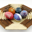 Stock Photo: Five painted eggs on wooden plate