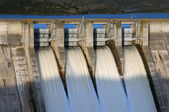 Gates open of dam — Stock Photo