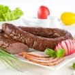 Sausage ring on a white plate - Stock Photo