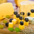 Cheese board, black and green olives. - Stock Photo