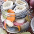 Pickled Herring in glass jar - Stock Photo