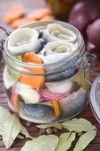 Pickled Herring in glass jar — Stock Photo
