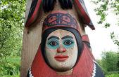 Totem pole face in Alaska Native Heritage Center — Stock Photo