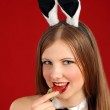 Playboy girl. The beautiful girl with a strawberry — Stock Photo #4879627