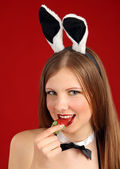 Playboy girl. The beautiful girl with a strawberry — Zdjęcie stockowe