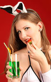 The beautiful girl and a strawberry — Stockfoto
