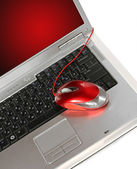 Red computer mouse on a laptop — Stock Photo