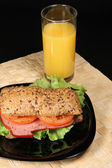 Sandwich and orange juice — Stock Photo