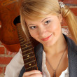 Blond with guitar — Stock Photo