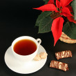 Stock Photo: Red poinsettiand tea