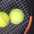 Stock Photo: Tennis racket and balls on black