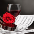 Stock Photo: Notes, wine, guitar and rose