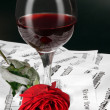 Notes, wine and rose — Stock Photo