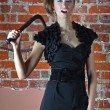 Stock Photo: Girl with whip and paint