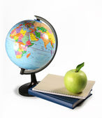 Apple, globe and books — Stock Photo