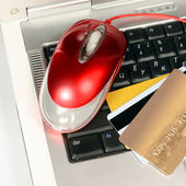 Laptop and credit cards — Stock Photo