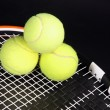 Stok fotoğraf: Tennis racket and balls on black