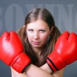 Women boxing punching red gloves — Stock Photo