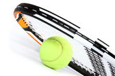 Tennis racket and ball on white — Stock Photo