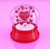 снежный шар с сердечками на розовом фоне — Стоковое фото