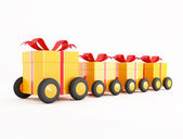 Orange gift box covoy on wheels — Stock Photo