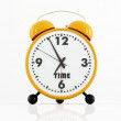 Orange and black alarm clock — Stock Photo