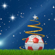 Christmas soccerball and comet — Stock Photo