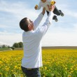Family Fun - Father and Son in dandelion field - Stock Photo