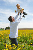 Family Fun - Father and Son in dandelion field — Stock Photo