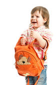 Kid with a rucksack crying — Stock Photo
