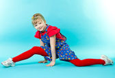 Little gymnast doing exercise — Foto Stock