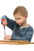 A boy with a screwdriver — Stock Photo