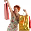 Shopping. Happy woman with different bags with purchases — Stock Photo