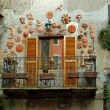 Balcony with ceramics masks in Italy - Stock Photo