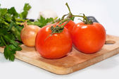 Fresh tomatoes and onion close up — Stock Photo