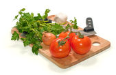 Fresh tomatoes, onion, garlic and parsley isolated on white — Stock Photo