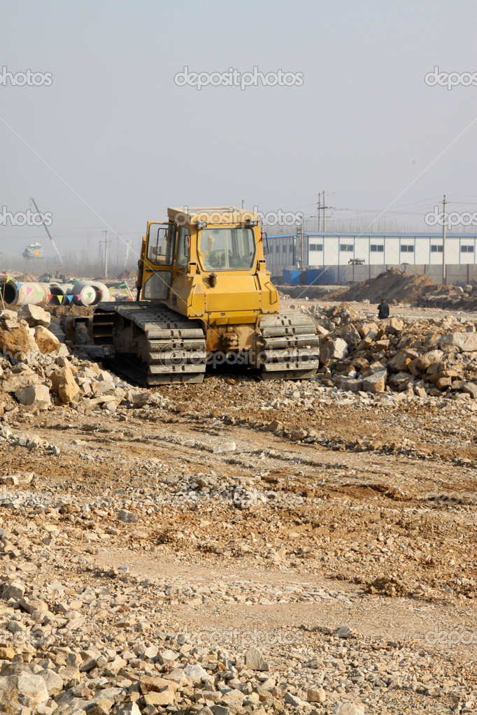 Excavator on the building construction site,take photos in Luannan County, Hebei Province, China.  Stock Photo #5357466