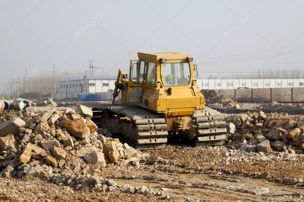 Excavator on the building construction site,take photos in Luannan County, Hebei Province, China.  Stock Photo #5357467