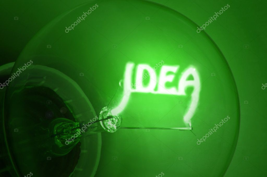 Close up of green illuminated light bulb filament spelling the word IDEA — Stock Photo #4930038