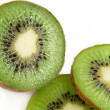 Stock Photo: Partially sliced kiwi fruit