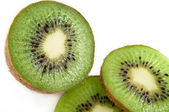 Partially sliced kiwi fruit — Stockfoto